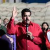 In this photo provided by Miraflores Presidential Press Office, Venezuela\'s Vice-President Nicolas Maduro, center, delivers a speech during a visit to