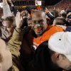 OSU\'s Richetti Jones (99) makes his way through celebrating fans on the field after the Bedlam college football game between the Oklahoma State University Cowboys and the University of Oklahoma Sooners at Boone Pickens Stadium in Stillwater, Okla., Saturday, Dec. 3, 2011. OSU beat OU, 44-10. Photo by Nate Billings, The Oklahoman