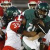 Edmond Santa Fe\'s Cameron Westbrook tries to fight off Lawton\'s Neville Abram during their high school football game at Wantland Stadium in Edmond, Okla., Thursday, October 11, 2012. Photo by Bryan Terry, The Oklahoman