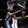 Oklahoma City\'s Kevin Durant (35) shoots a lay up as Denver\'s Chris Andersen (11) defends during the NBA basketball game between the Oklahoma City Thunder and the Denver Nuggets at the Chesapeake Energy Arena, Sunday, Feb. 19, 2012. Photo by Sarah Phipps, The Oklahoman