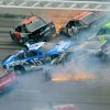 Drivers including Jamie McMurray (1), Clint Bowyer (15), Kurt Busch (78), Bobby Labonte, Ryan Newman (39 and David Stremme (30) collide in Turn 3 during the NASCAR Sprint Cup Series Aaron\'s 499 auto race at Talladega Superspeedway in Talladega, Ala., Sunday, May 5, 2013. (AP Photo/Greg McWilliams)