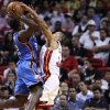 Miami Heat\'s Michael Beasley (30) tries to block a shot by Oklahoma City Thunder\'s Jeff Green (22) during second half of a NBA basketball game in Miami, Tuesday, Nov. 17, 2009. The Thunder won 100-87. (AP Photo/J Pat Carter)