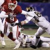 Photo - Oklahoma's Juaquin Iglesias (9) breaks away from Missouri's Forrest Shock (88) during the first half of the Big 12 Championship college football game between the University of Oklahoma Sooners (OU) and the University of Missouri Tigers (MU) on Saturday, Dec. 6, 2008, at Arrowhead Stadium in Kansas City, Mo. 
