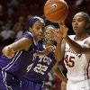 Oklahoma\'s Jasmine Hartman (45) passes the ball beside TCU\'s Ashley Colbert (44) during a women\'s college basketball game between the University of Oklahoma and TCU at the Llyod Noble Center in Norman, Okla., Wednesday, Jan. 30, 2013. Oklahoma won 74-53. Photo by Bryan Terry, The Oklahoman