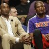 Photo - Los Angeles Lakers Kobe Bryant, left, sits with West Team's Kevin Durant, of the Oklahoma City Thunder during the NBA All Star basketball game, Sunday, Feb. 16, 2014, in New Orleans. (AP Photo/Gerald Herbert)