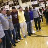 Members of the Jenks high school football team including Taylor Hunter (left), Brandon Waggoner, Braden Calip, Garrett Patterson, Nick Lucido, Trey\'vonne Barre, Jeff Scallion, and Jordan Smallwood pose for a photo for family and friends during signing day in Jenks, Okla., on February 6,2013. JAMES GIBBARD/Tulsa World