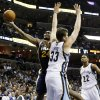 Photo -   Utah Jazz forward Paul Millsap (24) goes to the basket against Memphis Grizzlies center Marc Gasol (33), of Spain, and forward Rudy Gay (22) in the first half of an NBA basketball game, Monday, Nov. 5, 2012, in Memphis, Tenn. (AP Photo/Lance Murphey)