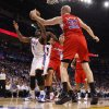Oklahoma City\'s Kendrick Perkins (5) grabs a rebound in front of Los Angeles Clippers\' Blake Griffin (32) and Chris Kaman (35) during the NBA basketball game between the Oklahoma City Thunder and the Los Angeles at the Oklahoma City Arena, Wednesday, April 6, 2011. Photo by Bryan Terry, The Oklahoman