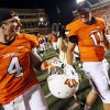 OSU quarterbacks J.W. Walsh, left, and Wes Lunt talk as they leave the field after a college football game between Oklahoma State University and Savannah State University at Boone Pickens Stadium in Stillwater, Okla., Saturday, Sept. 1, 2012. OSU won, 84-0. Photo by Nate Billings, The Oklahoman