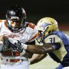 Norman\'s Imond Robinson is tackled by Southmoore\'s Terrance Bonner during the first half in Moore, Friday October 12, 2012. Photo By Steve Gooch, The Oklahoman