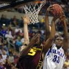NCAA COLLEGE BASKETBALL TOURNAMENT AT THE FORD CENTER IN OKLAHOMA CITY: Kansas VS Arizona State, Saturday March. 22, 2003) Arizona\'s Ike Diogu & KU\'s Bryant Nash battle for a rebound during the first half. Staff Photo By Steve Gooch