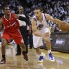 Golden State Warriors\' Stephen Curry (30) dribbles past Los Angeles Clippers\' Chris Paul (3) during the second half of an NBA basketball game in Oakland, Calif., Wednesday, Jan. 2, 2013. Golden State won 115-94. (AP Photo/Marcio Jose Sanchez)