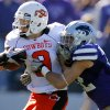 Oklahoma State\'s Bo Bowling (9) is hit by Kansas State\'s Ty Zimmerman (12) during the first half of the college football game between the Oklahoma State University Cowboys (OSU) and the Kansas State University Wildcats (KSU) on Saturday, Oct. 30, 2010, in Manhattan, Kan. Photo by Chris Landsberger, The Oklahoman