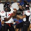 Westmmore\'s Devon Hollin (37), left, and Ethan Baker (10) celebrate after Hollin intercepted a pass during the Moore War high school football game between Moore and Westmoore in Moore, Okla., Friday, September 5, 2008. NATE BILLINGS, THE OKLAHOMAN