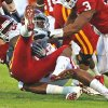 Frank Alexander (84) brings down Shontrelle Johnson (25) during the first half of the college football game between the University of Oklahoma Sooners (OU) and the Iowa State Cyclones (ISU) at the Glaylord Family-Oklahoma Memorial Stadium on Saturday, Oct. 16, 2010, in Norman, Okla. Photo by Steve Sisney, The Oklahoman
