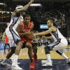 Photo - Houston Rockets forward Terrence Jones (6) drives between Memphis Grizzlies forwards Zach Randolph, left, and Courtney Lee (5) in the first half of an NBA basketball game, Saturday, Jan. 25, 2014, in Memphis, Tenn. (AP Photo/Lance Murphey)