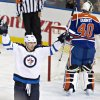 Photo - Winnipeg Jets' Blake Wheeler (26) celebrates a goal against Edmonton Oilers goalie Devan Dubnyk (40) during the first period of an NHL hockey game Tuesday, Oct. 1, 2013, in Edmonton, Alberta. (AP Photo/The Canadian Press, Jason Franson)