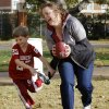 Lisa Hurtt and her son Trey play football together while tailgating before the start of the college football game between the University of Oklahoma Sooners (OU) and the Iowa State University Cyclones (ISU) at Gaylord Family-Oklahoma Memorial Stadium in Norman, Okla. on Saturday, Nov. 16, 2013. Photo by Chris Landsberger, The Oklahoman
