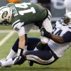 Photo - New York Jets quarterback Greg McElroy (14) is brought down by San Diego Chargers defensive end Corey Liuget during the second half of an NFL football game on Sunday, Dec. 23, 2012, in East Rutherford, N.J. (AP Photo/Bill Kostroun)