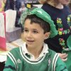 First-grader Will Leonard wears a hat he made from newspaper, painted green and adorned with a coin for luck at Christ the King Elementary School to celebrate St. Patrick\'s Day, Friday, March 16, 2012. Photo By David McDaniel/The Oklahoman