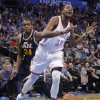 Oklahoma City Thunder\'s Kevin Durant (35) is fouled by Utah Jazz\'s Paul Millsap (24) during the NBA basketball game between the Oklahoma City Thunder and the Utah Jazz at Chesapeake Energy Arena on Wednesday, March 13, 2013, in Oklahoma City, Okla. Photo by Chris Landsberger, The Oklahoman