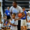 Mason Lee, 10, gets a picture made with Kevin Durant during Durant\'s basketball camp on Thursday, Aug. 7, 2014 in Moore, Okla. Photo by Steve Sisney, The Oklahoman