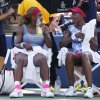 Photo - Serena, left, and Venus Williams take a break between games against Garbine Muguruza and Carla Suarez Navarro, of Spain, during a doubles match at the 2014 U.S. Open tennis tournament, Sunday, Aug. 31, 2014, in New York. (AP Photo/Seth Wenig)