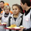 Volunteers accompany dinner guests through the serving line. A girl looks at the selections of food from which she can select. Hundreds were served a traditional Christmas meal at the annual Red Andrews Dinner inside the Cox Convention Center on Christmas Day, Dec. 25, 2012. An army of volunteers showed up despite snow and ice and hazardous driving conditions. They accompanied each guest through the serving line and carried their trays and seated them at their tables. Other volunteers distributed a small mountain of toys and stuffed animals that were donated for the event. Photo by Jim Beckel, The Oklahoman