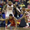 Iowa State\'s Will Clyburn (21) dives for a loose ball as Oklahoma\'s Romero Osby (24) and Oklahoma\'s Steven Pledger (2) defend during the Phillips 66 Big 12 Men\'s basketball championship tournament game between the University of Oklahoma and Iowa State at the Sprint Center in Kansas City, Thursday, March 14, 2013. Photo by Sarah Phipps, The Oklahoman