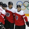 Photo - Austria celebrates a first period goal against Finland during a men's ice hockey game at the 2014 Winter Olympics, Thursday, Feb. 13, 2014, in Sochi, Russia. (AP Photo/Mark Humphrey)