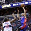 Photo - Detroit Pistons forward Tayshaun Prince (22) releases a shot in front of Washington Wizards forward Kevin Seraphin (13) during the first half of an NBA basketball game, Saturday, Dec. 22, 2012, in Washington. (AP Photo/Nick Wass)
