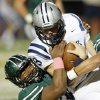 Norman North\'s Justin Martin (45) brings down Edmond North quarterback Luke Hoskins (9) on a keeper during a high school football game between Edmond North and Norman North in Norman, Okla., Thursday, Oct. 11, 2012. Photo by Nate Billings, The Oklahoman