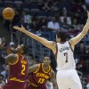 The Milwaukee Bucks\' Ersan Ilyasova can\'t get a hold on the ball and Cleveland Cavaliers\' Kyrie Irving comes up with it during the first half of an NBA basketball game, Saturday Nov. 3, 2012 in Milwaukee. (AP Photo/Tom Lynn)