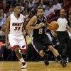 San Antonio Spurs\' Patrick Mills (8) drives around Miami Heat\'s Norris Cole (30) in the first half of an NBA basketball game on Thursday, Nov. 29, 2012, in Miami. ( AP Photo/Alan Diaz)