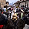 In this picture taken Sunday, Jan. 13, 2013, masked villagers parade during the carnival in Macedonia\'s southwestern village of Vevcani. Said to date from pagan times 1,400 years ago, the Vevcani carnival, with its colorful floats and masked revelers, has grown in popularity over the last decade and attracts thousands of visitors for the celebrations on St. Vasilij Day to welcome in the New Year according to the Julian calendar. (AP Photo/Boris Grdanoski)