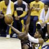 Indiana Pacers\' Paul George (24) shoots against Miami Heat\'s Joel Anthony during the first half of Game 3 of the NBA Eastern Conference basketball finals in Indianapolis, Sunday, May 26, 2013. (AP Photo/Michael Conroy)