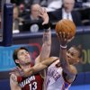 Oklahoma City\'s Russell Westbrook (0) shoots a lay up as Miami\'s Mike Miller (13) defends during Game 1 of the NBA Finals between the Oklahoma City Thunder and the Miami Heat at Chesapeake Energy Arena in Oklahoma City, Tuesday, June 12, 2012. Photo by Sarah Phipps, The Oklahoman