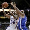 Kansas guard Travis Releford (24) gets past Saint Louis forward Dwayne Evans (21) to put up a shot during the first half of an NCAA college basketball game Tuesday, Nov. 20, 2012, in Kansas City, Mo. (AP Photo/Charlie Riedel)