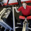 Photo -   In this June 14, 2012, photo, gym manager Rick Limitone demonstrates a work out machine at a Snap Fitness truck stop gym in Dallas. From trucking companies embracing wellness and weight-loss programs to gyms being installed at truck stops, momentum has picked up in recent years to help those who make their living driving big rigs get into shape. (AP Photo/LM Otero)