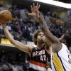 Photo - Portland Trail Blazers center Robin Lopez, left, shoots over Indiana Pacers center Roy Hibbert during the first half of an NBA basketball game in Indianapolis, Friday, Feb. 7, 2014.  (AP Photo/Michael Conroy)