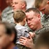 Ssgt. Arron McDaniel, of Broken Arrow, holds his 21 month-old son, Anthony, while he and fellow soldiers bow their heads for the invocation delivered by Chaplain Maj. Brad Hanna at the 45th Infantry Brigade Combat Team deployment ceremony inside the Cox Convention Center, Wednesday, Feb. 16, 2011. Photo by Jim Beckel, The Oklahoman