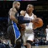 Photo - Oklahoma City's Russell Westbrook (0) tries to get the ball past Jameer Nelson (14) of Orlando during the NBA basketball game between the Orlando Magic and Oklahoma City Thunder in Oklahoma City, Thursday, January 13, 2011. Photo by Nate Billings, The Oklahoman