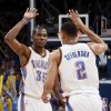Oklahoma City\'s Kevin Durant (35) and Thabo Sefolosha (2) celebrate during game one of the first round in the NBA playoffs between the Oklahoma City Thunder and the Dallas Mavericks at Chesapeake Energy Arena in Oklahoma City, Saturday, April 28, 2012. Oklahoma City won, 99-98. Photo by Nate Billings, The Oklahoman