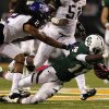 Photo -   Baylor wide receiver Tevin Reese (16) dives forward for extra yardage after reception as TCU 's Jason Verrett (2) gives chase in the first half of an NCAA college football game Saturday, Oct. 13, 2012, in Waco, Texas. (AP Photo/Tony Gutierrez)