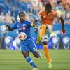 Photo - Montreal Impact's Patrice Bernier, left, and Houston Dynamo's Kofi Sarkodie battle for the ball during the first half of an MLS soccer game in Montreal, Sunday, June 29, 2014. (AP Photo/The Canadian Press, Graham Hughes)