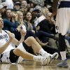 Dallas Mavericks\' Dirk Nowitzki, of Germany, gives a thumbs-up to teammate Jae Crowder, right, after Nowitzki was fouled attempting a 3-point shot during the second half of an NBA basketball game against the New Orleans Pelicans, Saturday, Jan. 11, 2014, in Dallas. Nowitzki sank all three foul shots in the 110-107 Mavericks win. (AP Photo/Tony Gutierrez)