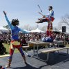 Cameron Tomele jugles perched atop James Freer\'s feet as Margaret Ebert frames the stage during a performance by Barely Balanced during the Medieval Fair at Reaves Park on Friday, April 5, 2013 in Norman, Okla. Photo by Steve Sisney, The Oklahoman