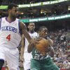 Boston Celtics\' Jordan Crawford (27) and Philadelphia 76ers\' Dorell Wright (4) fight for a rebound in the first half of an NBA basketball game, Tuesday, March 5, 2013, in Philadelphia. (AP Photo/H. Rumph Jr)