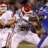 Oklahoma\'s Landry Jones (12) looks to pass the ball during the college football game between the University of Oklahoma Sooners (OU) and the University of Kansas Jayhawks (KU) on Saturday, Oct. 15, 2011. in Lawrence, Kan. Photo by Chris Landsberger, The Oklahoman