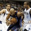 Photo - Charlotte Bobcats' Gerald Henderson, center, is fouled going to the basket  by Dallas Mavericks' Monta Ellis (11) as Jose Calderon, left, of Spain, stands by in the first half of an NBA basketball game Tuesday, Dec. 3, 2013, in Dallas. (AP Photo/Tony Gutierrez)